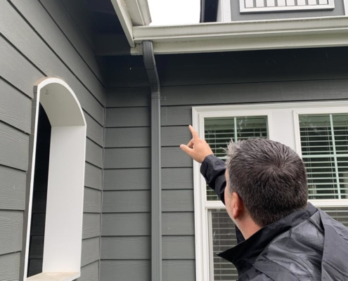 Max Stephenson, MaxPro Inspection Pointing to Roof Gutter